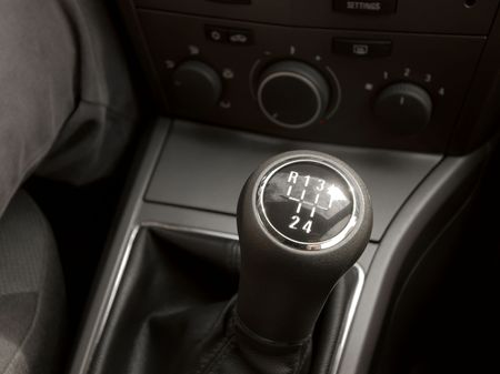 Manual gearstick in the cockpit of a car photo