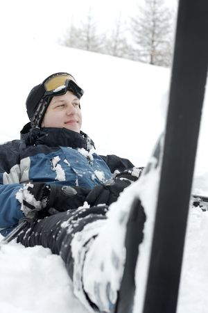 Young skier resting in the snow Stock Photo - 5596506
