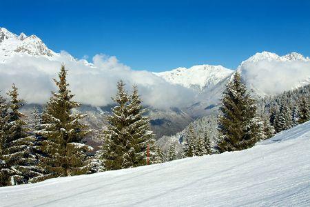 piste: Ski piste in a high mountain range