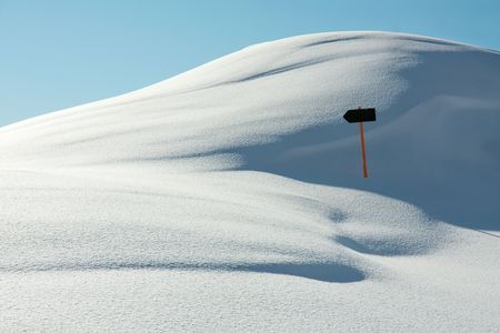 north pole: White, snowy landscape with a direction sign Stock Photo