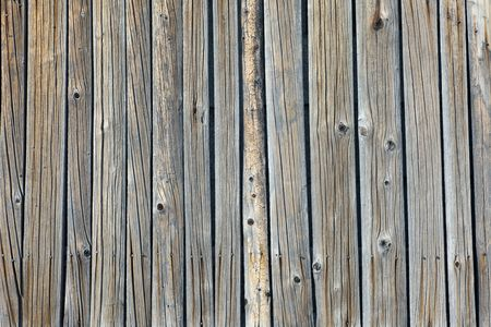 Old lumber texture of a wooden firewall photo