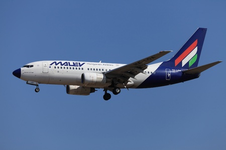 BUDAPEST, HUNGARY - OCTOBER 02 2011: Malev Hungarian Airlines Boeing 737 on final approach. Malev ceased all flying activity on 3 February 2012, after 66 years of service,