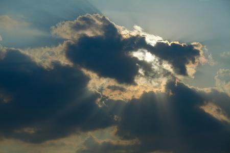 Dark clouds with sunrays photo