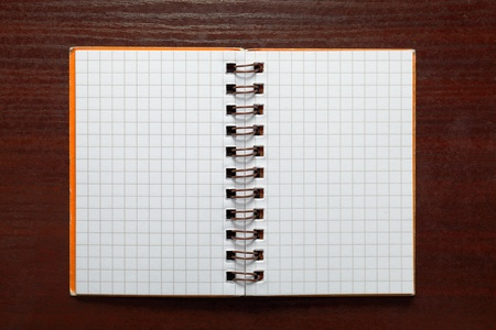 Notebook with square grid on a table photo
