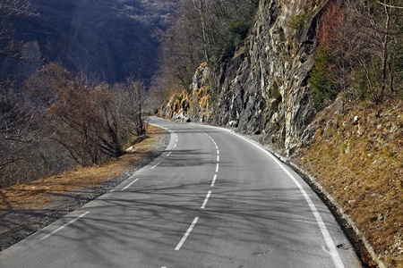 Mountain road by the cliffs photo
