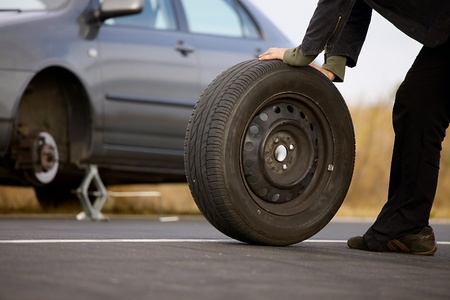 puncture: Changing wheels on a car