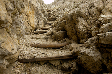 steep cliff: Stairs of a tight mountain path Stock Photo