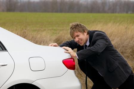 run down: Pushing a broken down car
