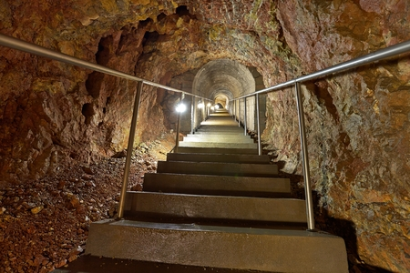 tunneling: Mining tunnel with lights and rails