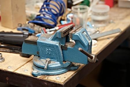 carpenter vise: Old vise on a workshop table