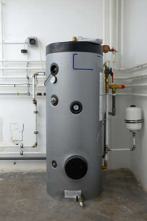 and heating: Boiler and pipes of the heating system of a house Stock Photo