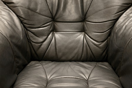 Leather armchair detail, classic style photo