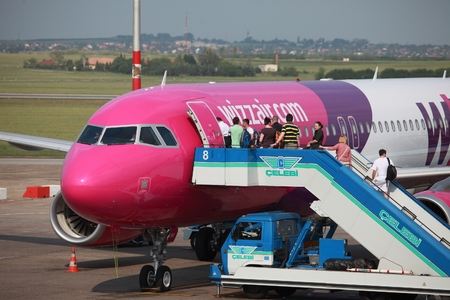 liszt: BUDAPEST, HUNGARY - MAY 5: Passengers boarding a Wizzair airliner at Budapest Liszt Ferenc Airport, May 5th 2012. Wizzair is a rapidly growing low-cost carrier based in Hungary. Editorial