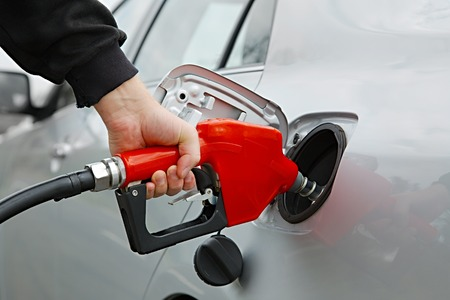 Fuel nozzle with hose isolated on white background photo