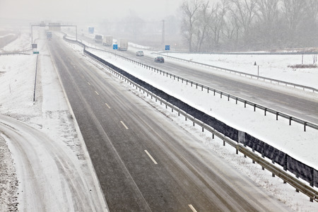 Highway traffic in heavy snowfall photo
