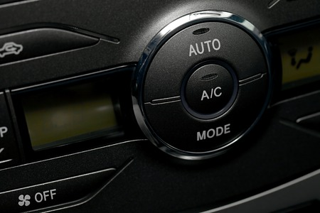 Air conditioning buttons of a car photo