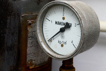 decadence: Manometer on an old rusty gas tank