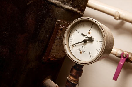pressurized: Manometer on an old rusty gas tank