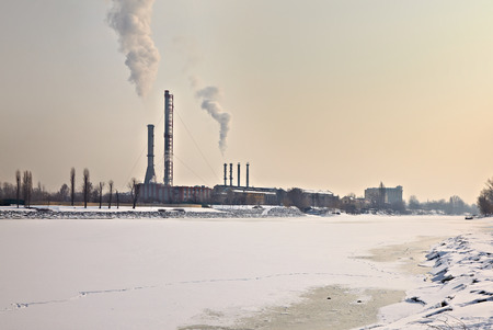 powerplant: Power station in winter by a frozen river