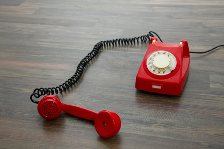 Red vintage phone on the floor photo