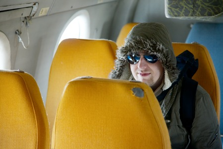 hijacker: Hooded man on an airplane