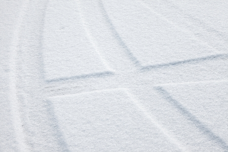 Trails of wheels in fresh snow photo