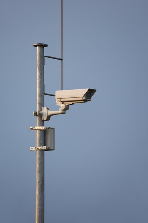 trespasser: Security camera on a mast Stock Photo