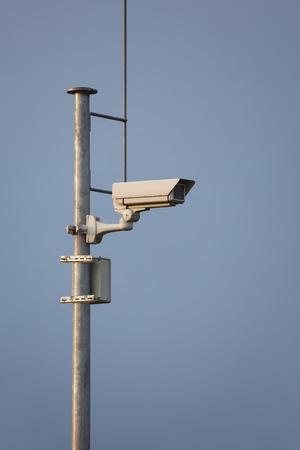 Security camera on a mast Stock Photo