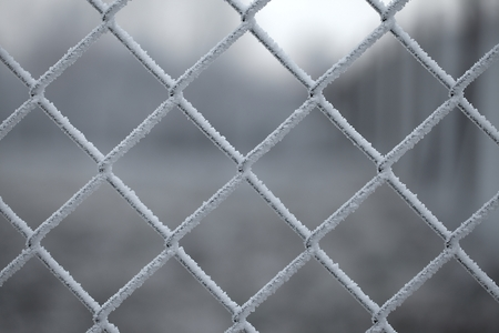 clod: Icy wire mesh fence in winter