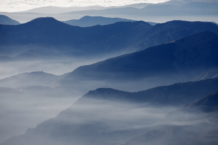 High mountain landscape in hazy weather Stock Photo