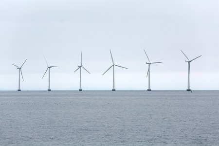 shore line: Offshore wind turbines at the sea in Copenhagen, Denmark Stock Photo