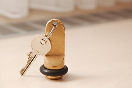 keyholder: Hotel room key on a table