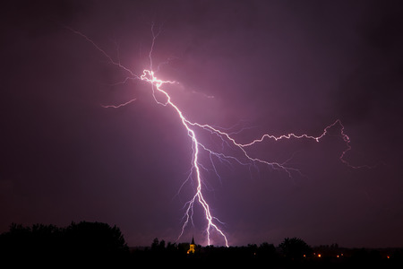 Lightning strikes from the evening sky photo