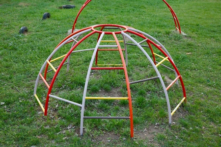 jungle gym: Colorful monkey bars on an old schoolyrd
