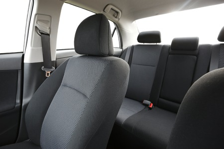open car door: Car interior with back seats