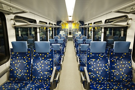 Interior of a passenger train with empty seats photo