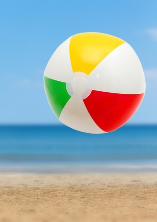 beach toys: Colorful ball on a sandy beach