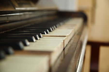 Old piano with faded keys photo