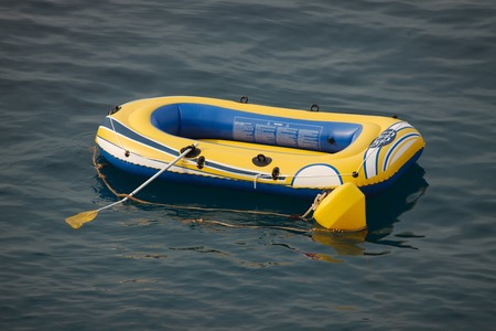 small boat: Inflatable boat on the water