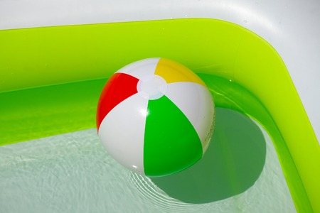 Rubber ball in a swimming pool photo