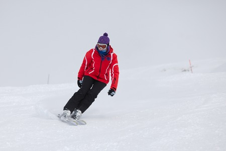skiing accident: Female skier coming down the slope Stock Photo