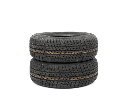 New tyres isolated on white photo
