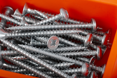 A pile of screws in a box photo