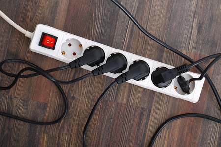 plugged in': Plugged in electric devices in an extension cord Stock Photo