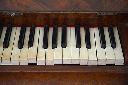 old piano: Old piano with faded keys Stock Photo