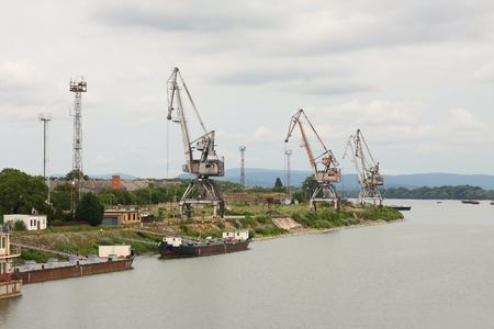 Industrial dock with cranes on the quay photo