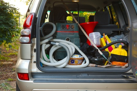Trunk of a car loaded with equipment photo