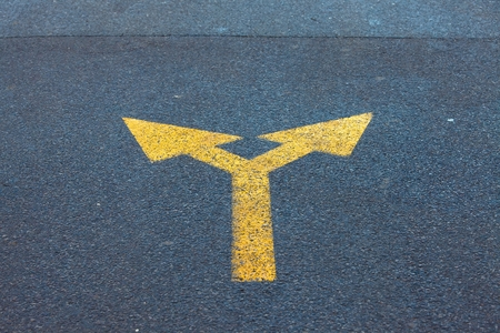 two way: Arrow sign on the asphalt road