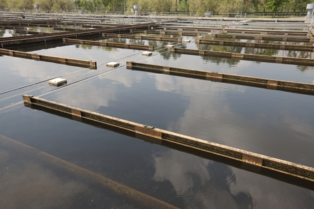 Wastewater treatment plant aerating basin photo