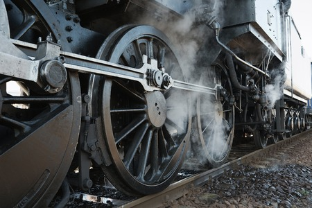 Steam locomotive rolling by close photo